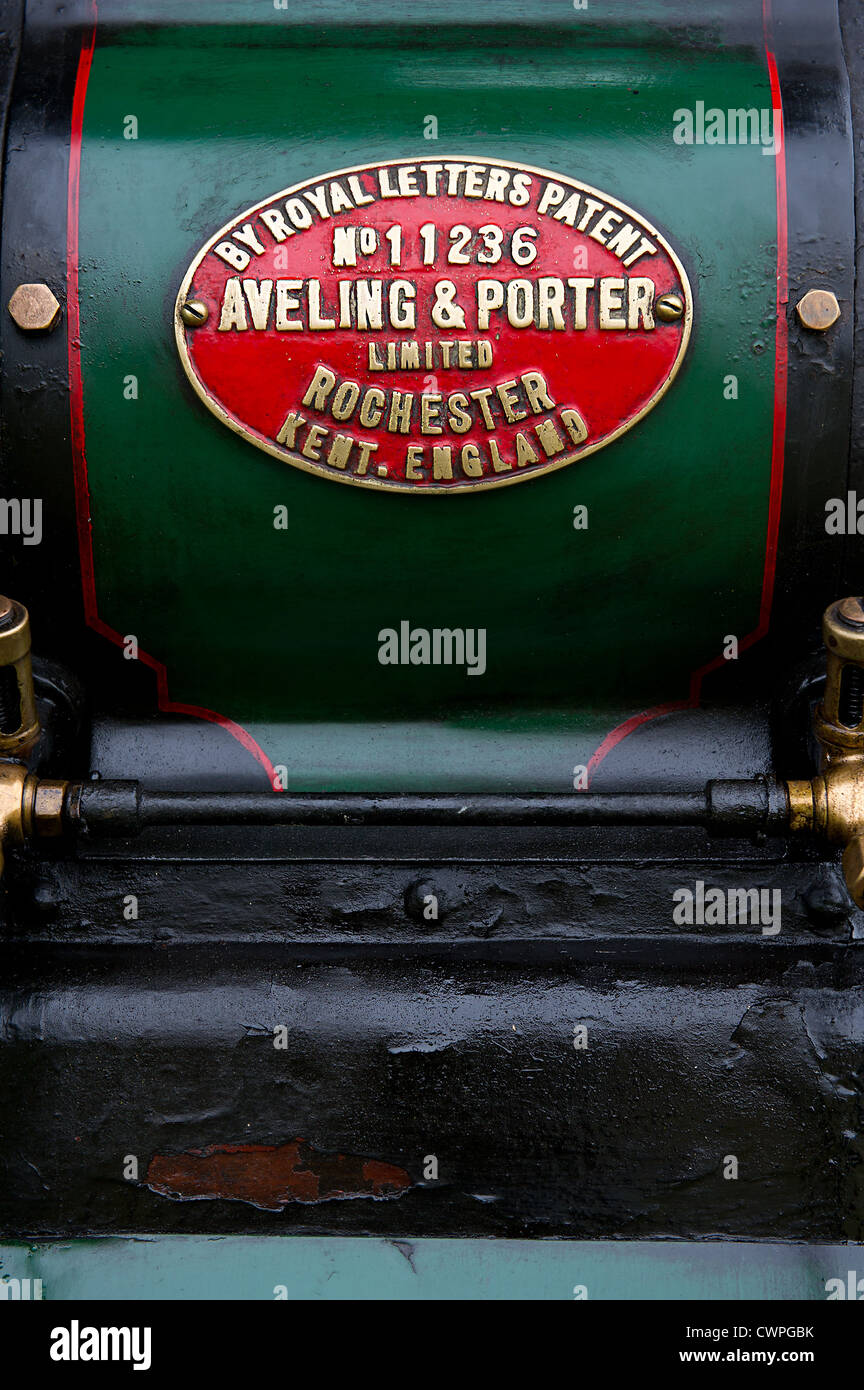 A makers plate on the side of the boiler of a vintage steam engine - Stock Image