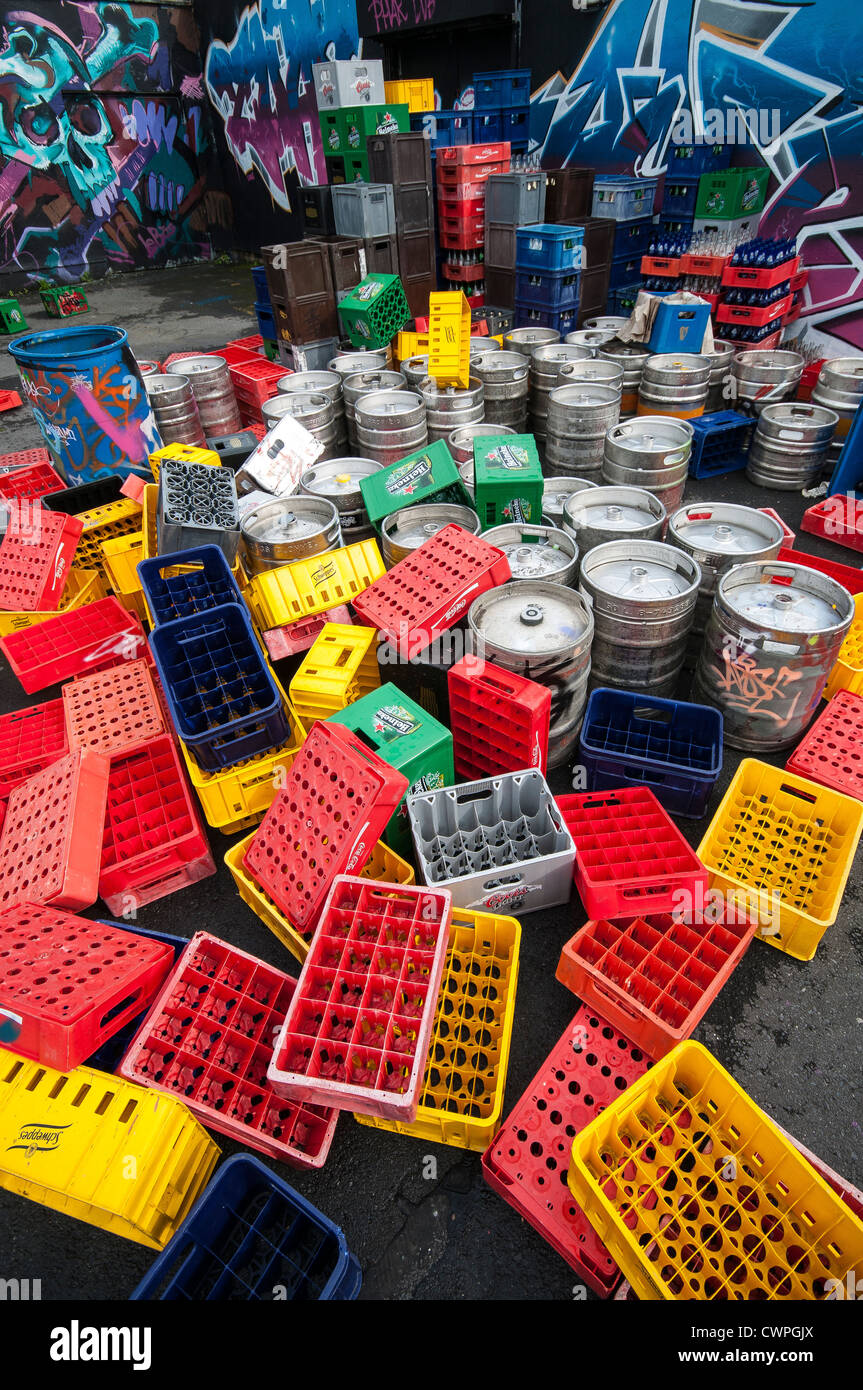 A collection of beer kegs barrels beer bottle and crates - Stock Image