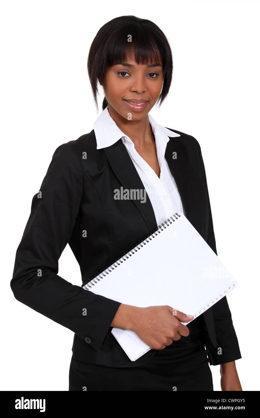 African woman with notebook in hand - Stock Image
