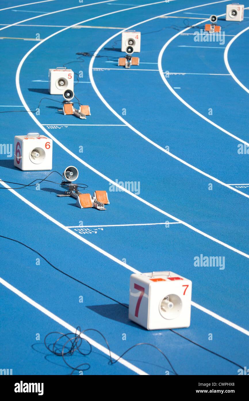 Start block of sprinters and loudspeaker - Stock Image