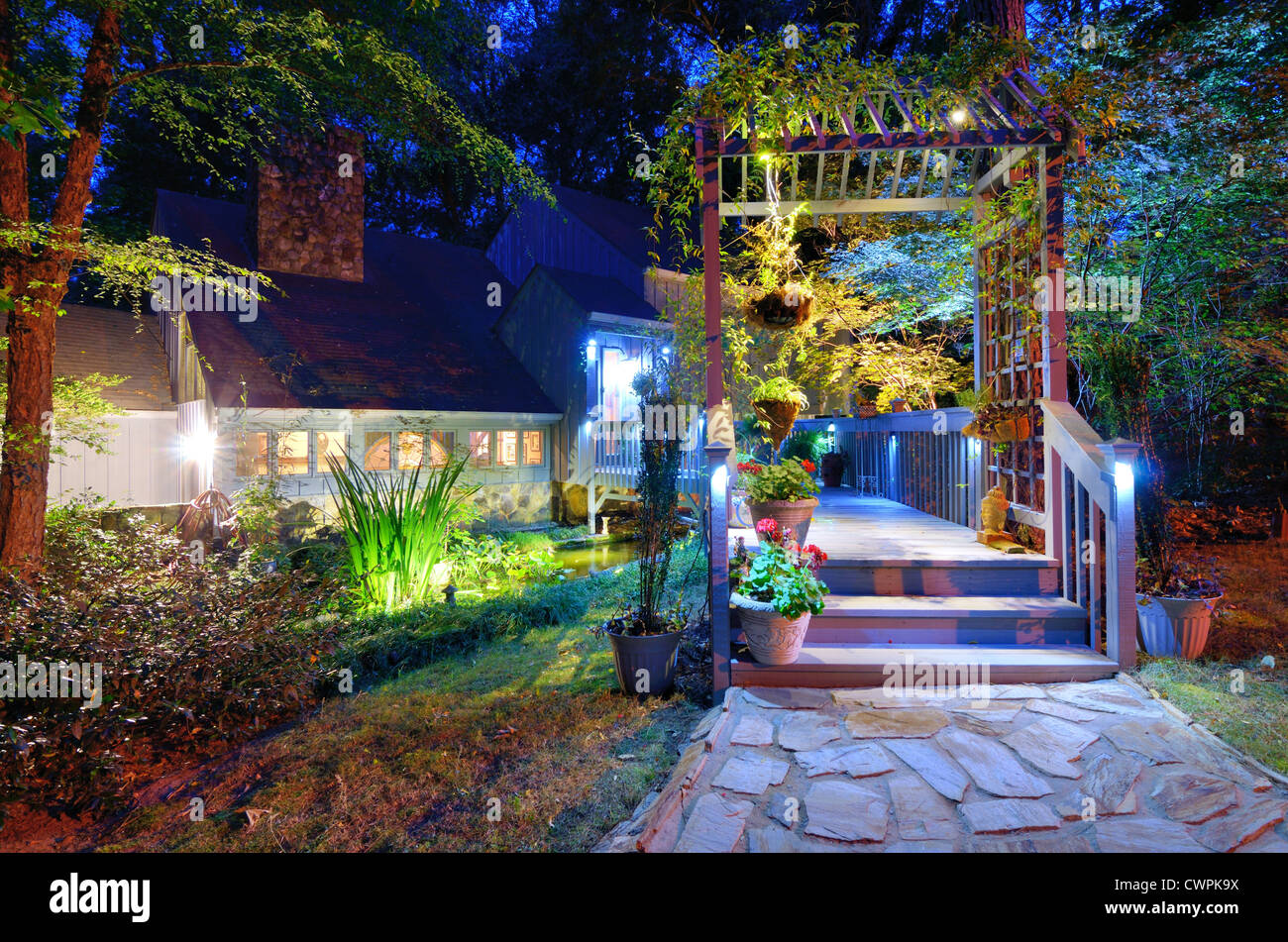 Walkway and front porch of a nice house in the woods. - Stock Image
