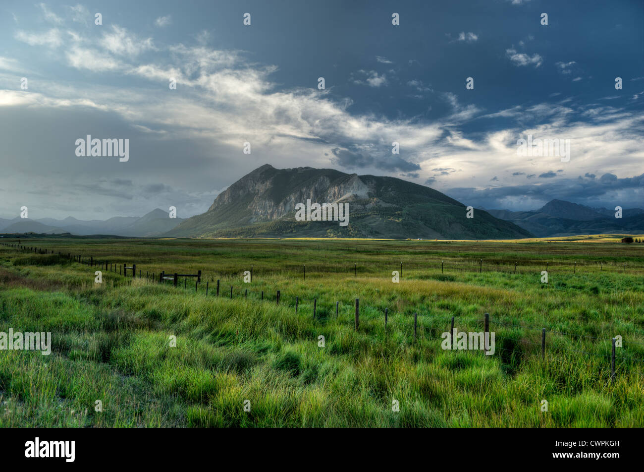 Crested Butte the mountain, right next to the Colorado town of the same name, at sundown on a late summer day. - Stock Image