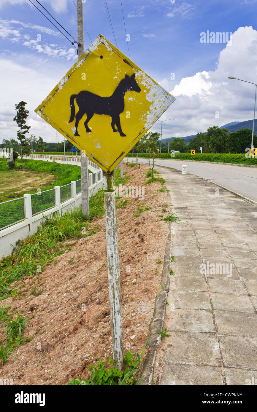 Traffic Sign warns Driver about Horses Crossing Road. - Stock Image