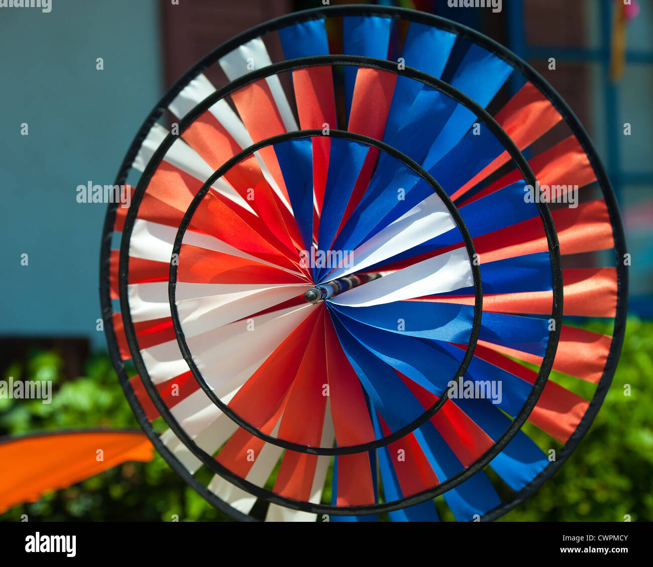 Multi wheel cloth windmill - Stock Image