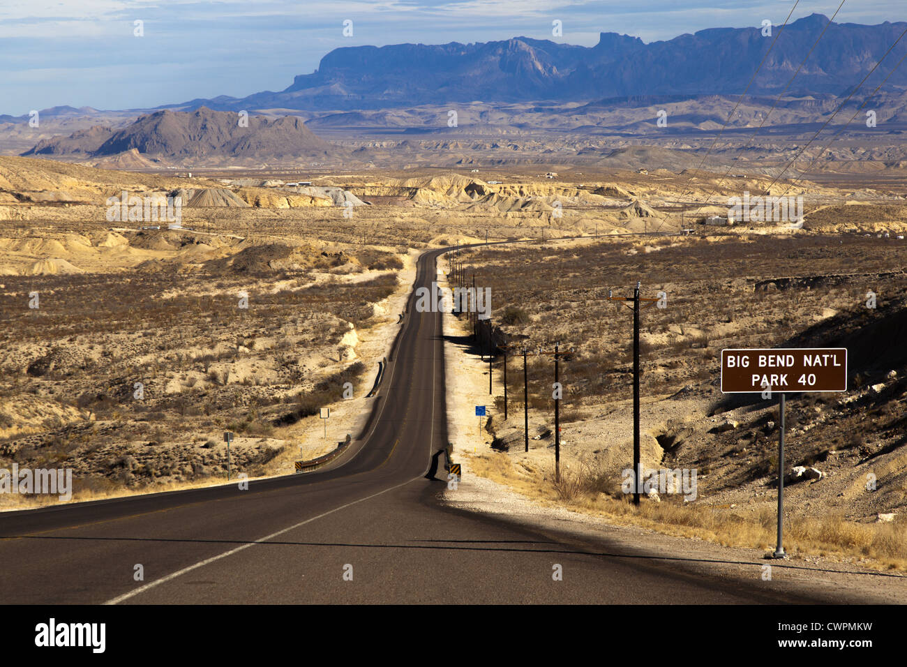 Long straight desert road vanshing into the distance leading to Big Bend National Park, Texas, United States Stock Photo