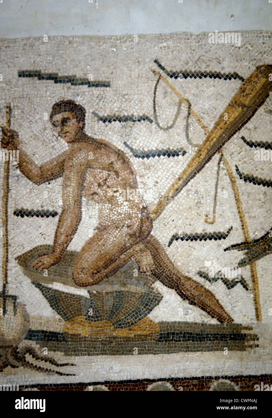 Roman mosaic of man spearing an octopus in the Bardo Museum Tunisia - Stock Image