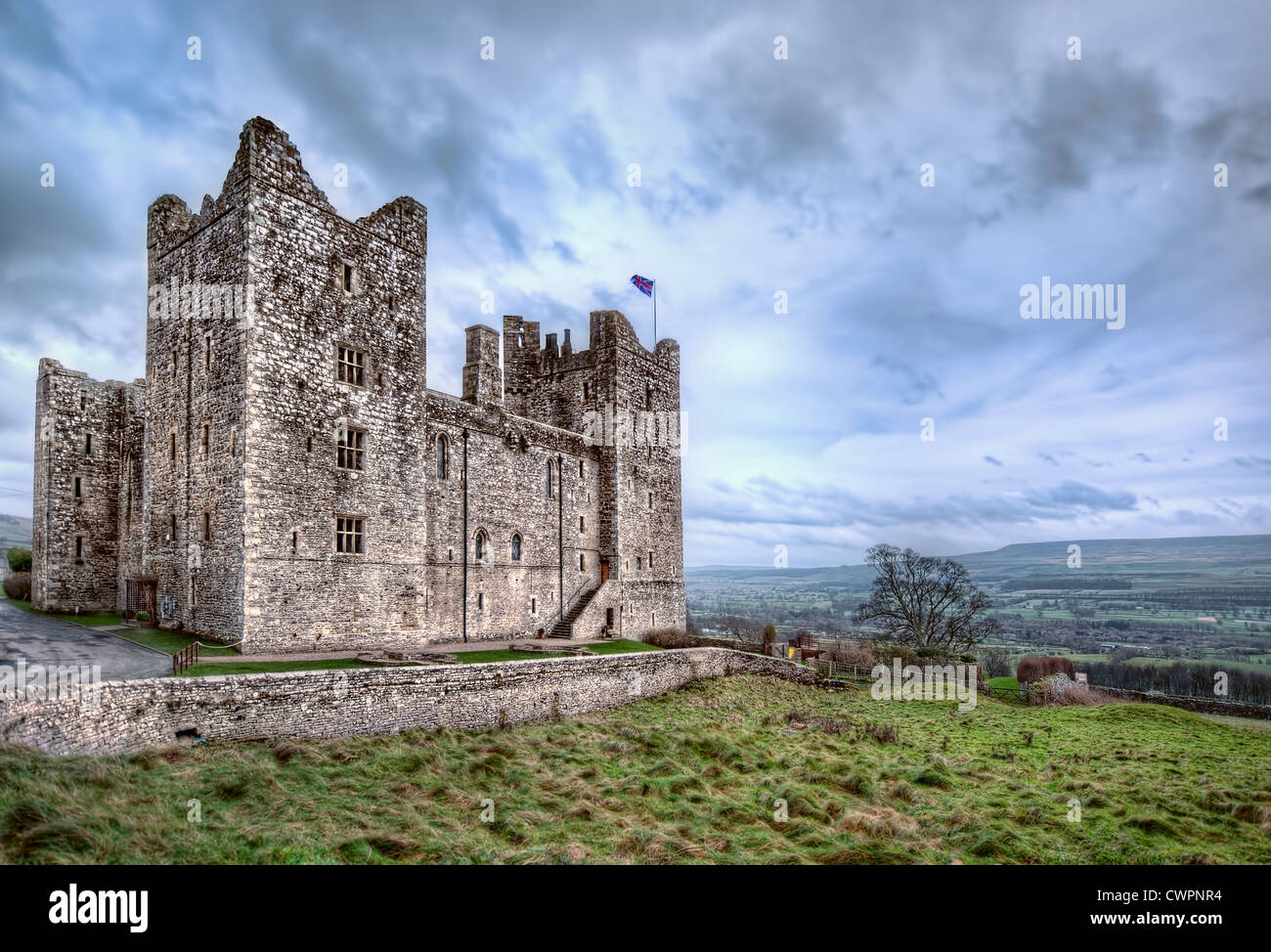 The medieval Bolton Castle in Yorkshire, England stands on a hill overlooking the ancient countryside - Stock Image