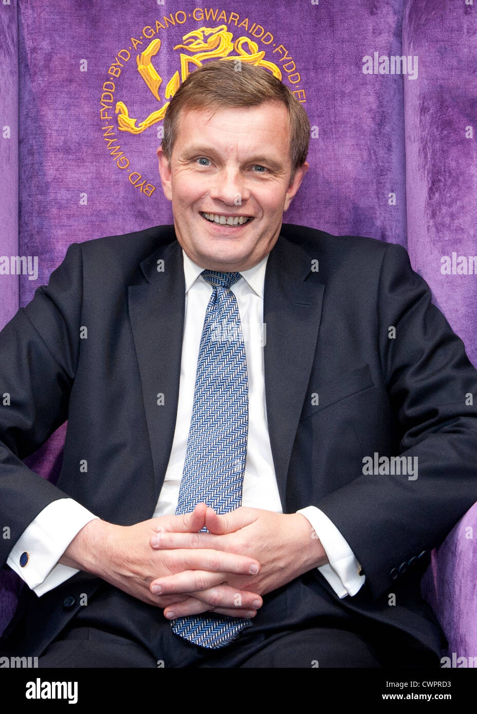 Member of Parliament for Clwyd West, David Jones MP sitting on a  throne at the 2012 Llangollen International Musical - Stock Image