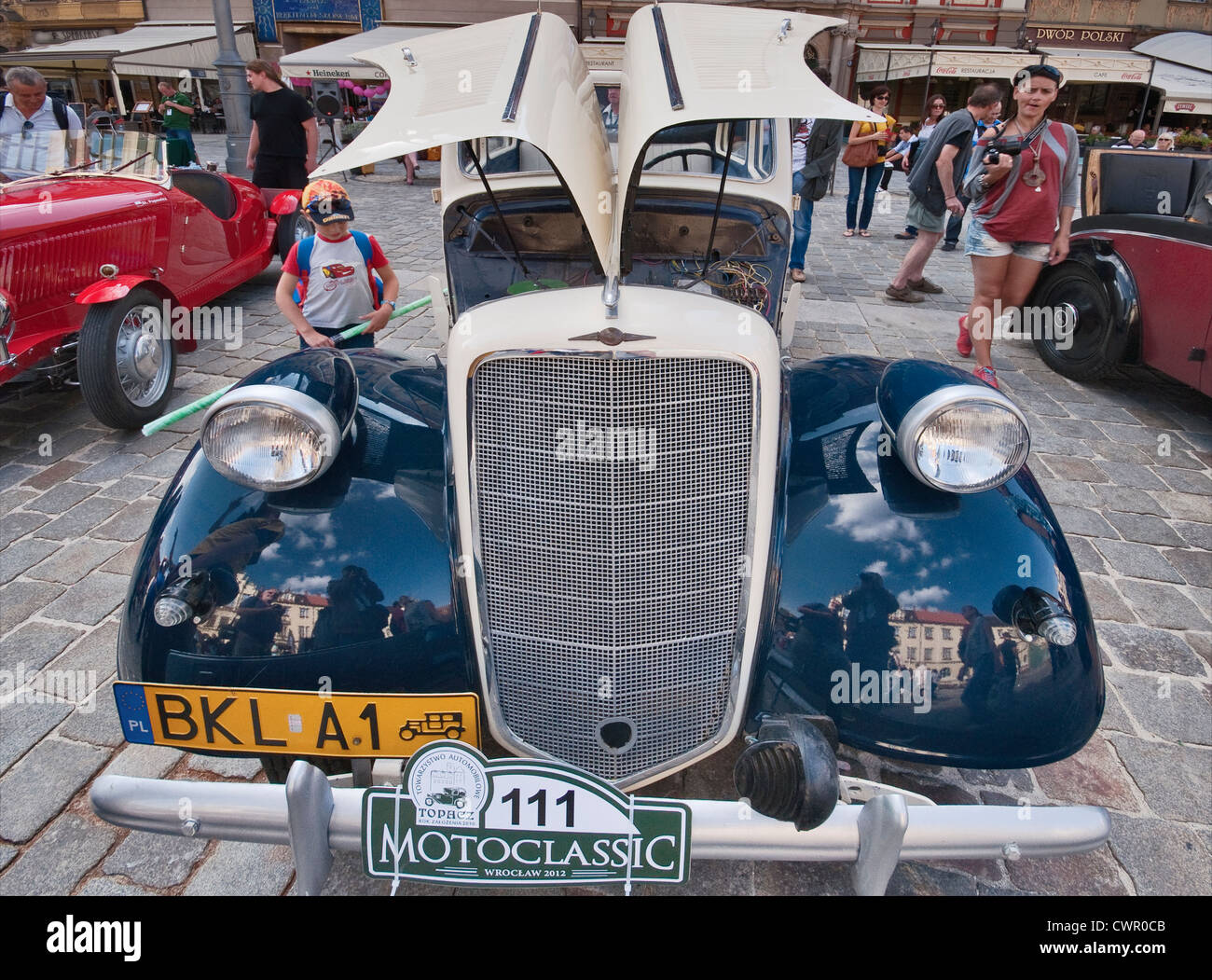 1934 Opel 2.0 L open-top sedan at Motoclassic car show at Rynek (Market Square) in Wroclaw, Lower Silesia, Poland - Stock Image