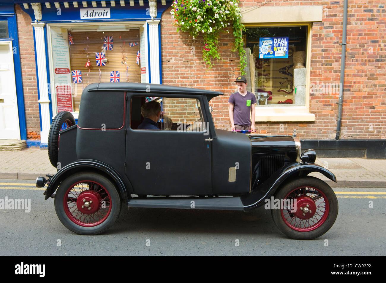 Old saloon car in parade of vintage cars at opening of Bromyard Hop ...