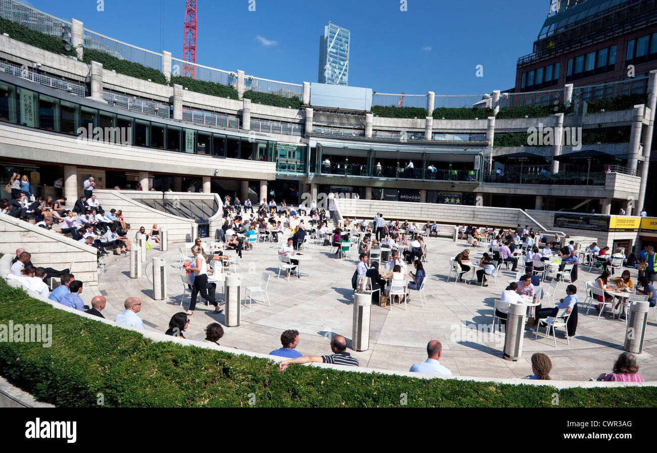 City workers enjoy lunch al fresco in Broadgate Circle, London - Stock Image