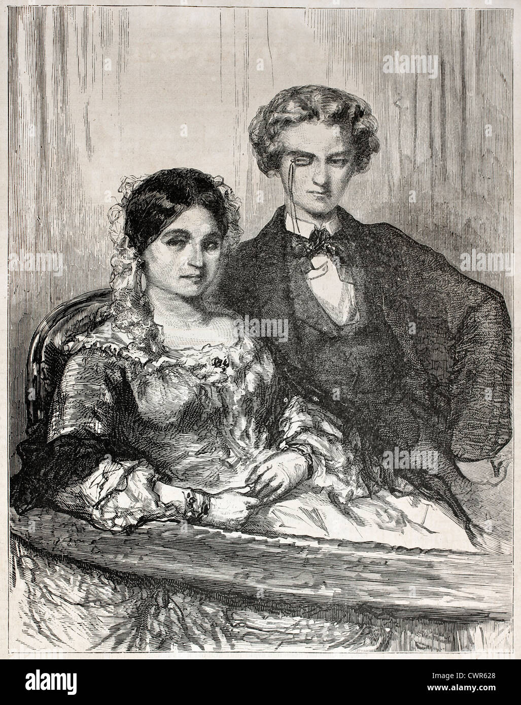 Couple watching a theatrical drama - Stock Image