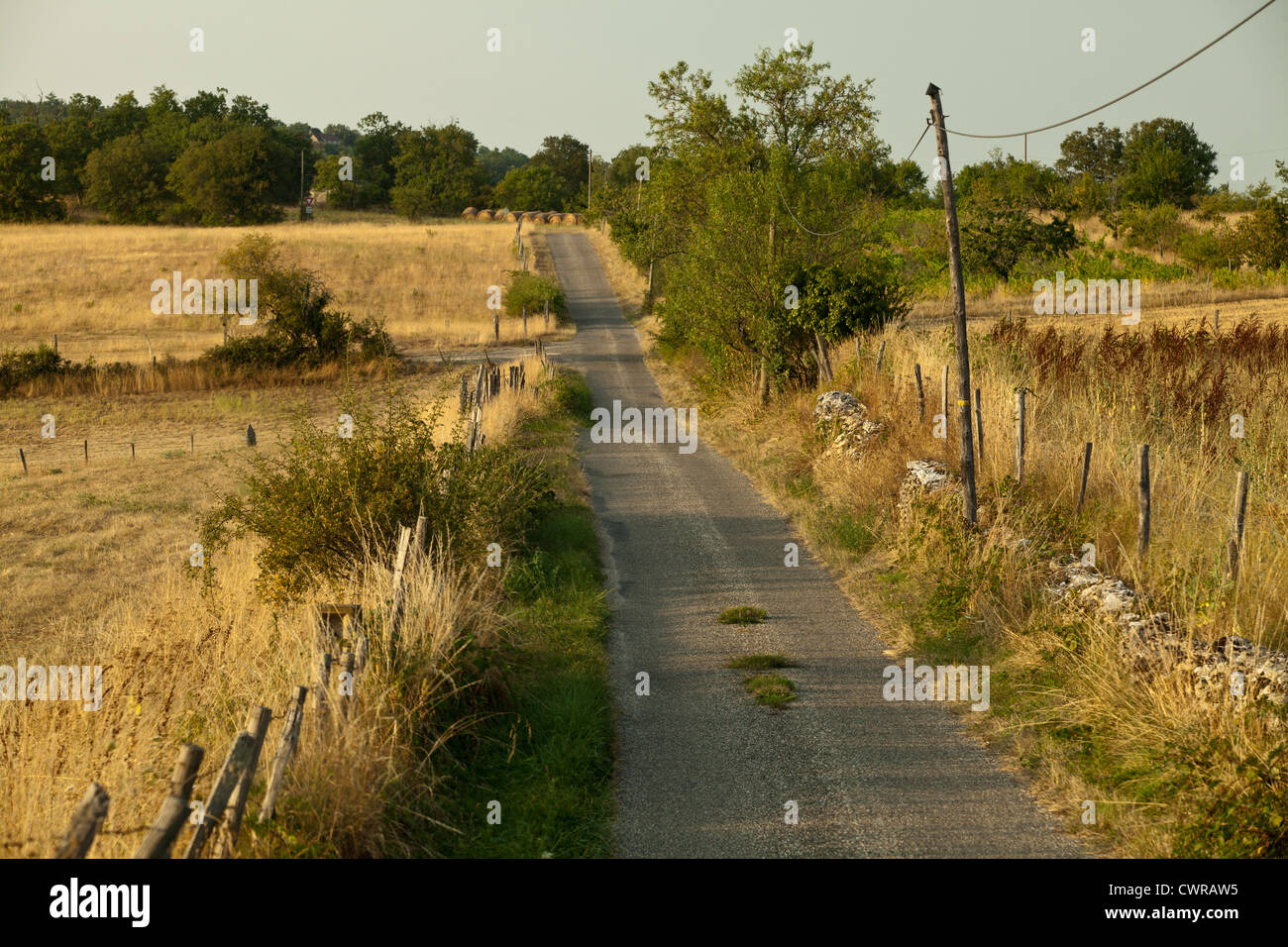 A country road in the Lot region of France. Stock Photo