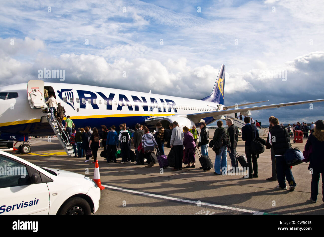 Passengers boarding a Ryanair flight - Stock Image
