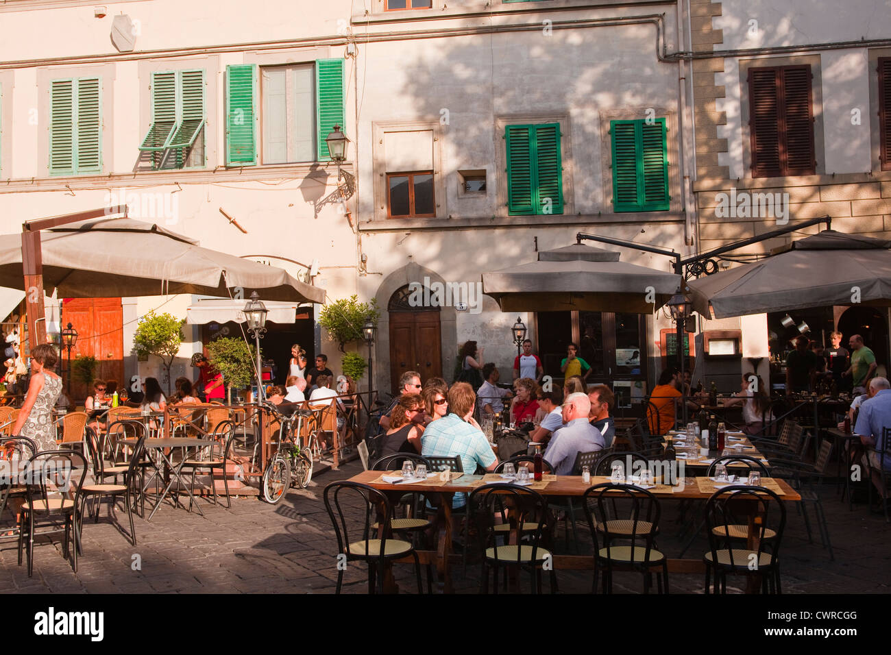 People eating at a restaurant in Piazza santo Sprito in Florence, Italy. - Stock Image