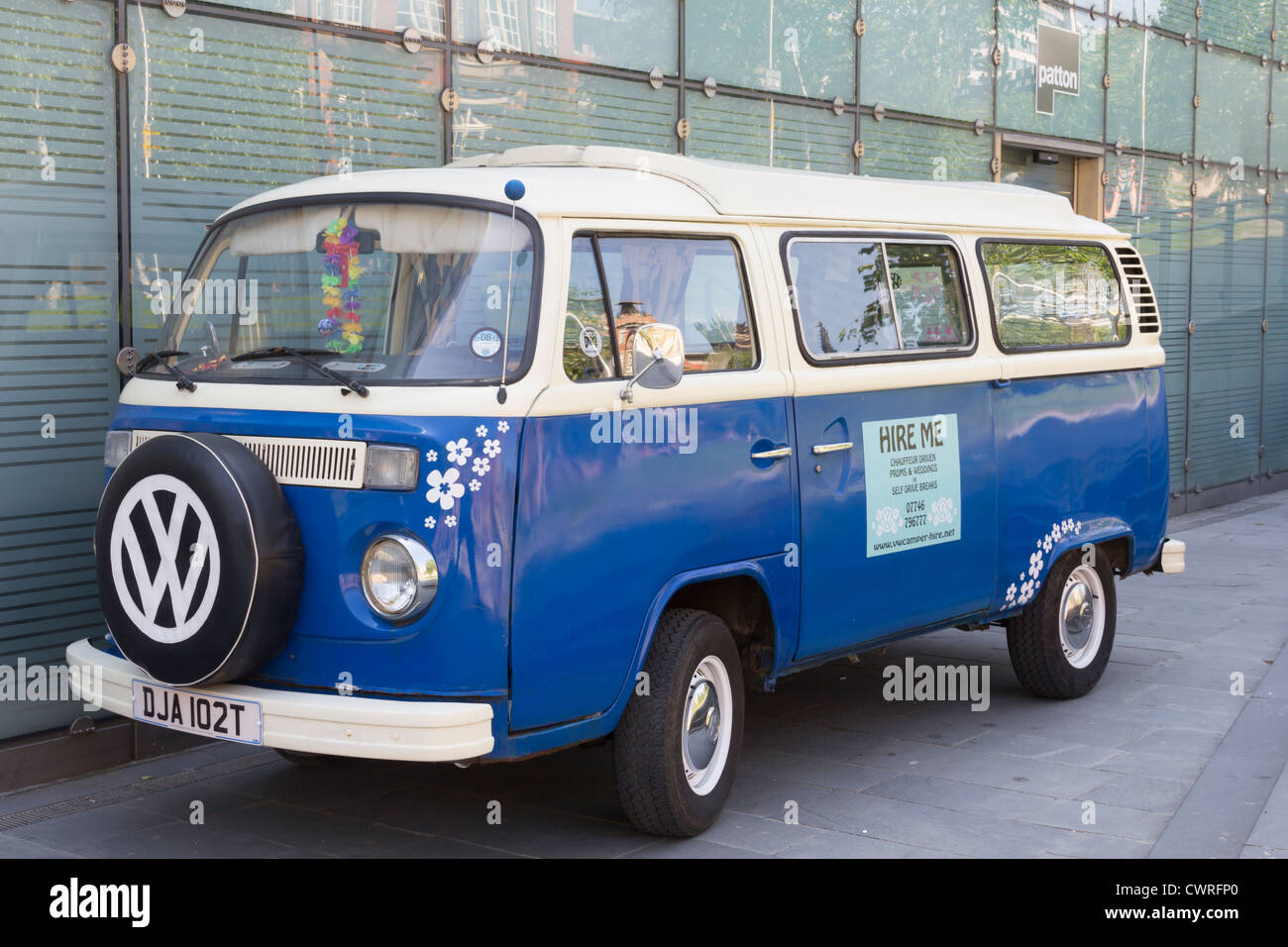 Blue classic car Volkswagen camper van available for hire, parked in central Manchester. - Stock Image
