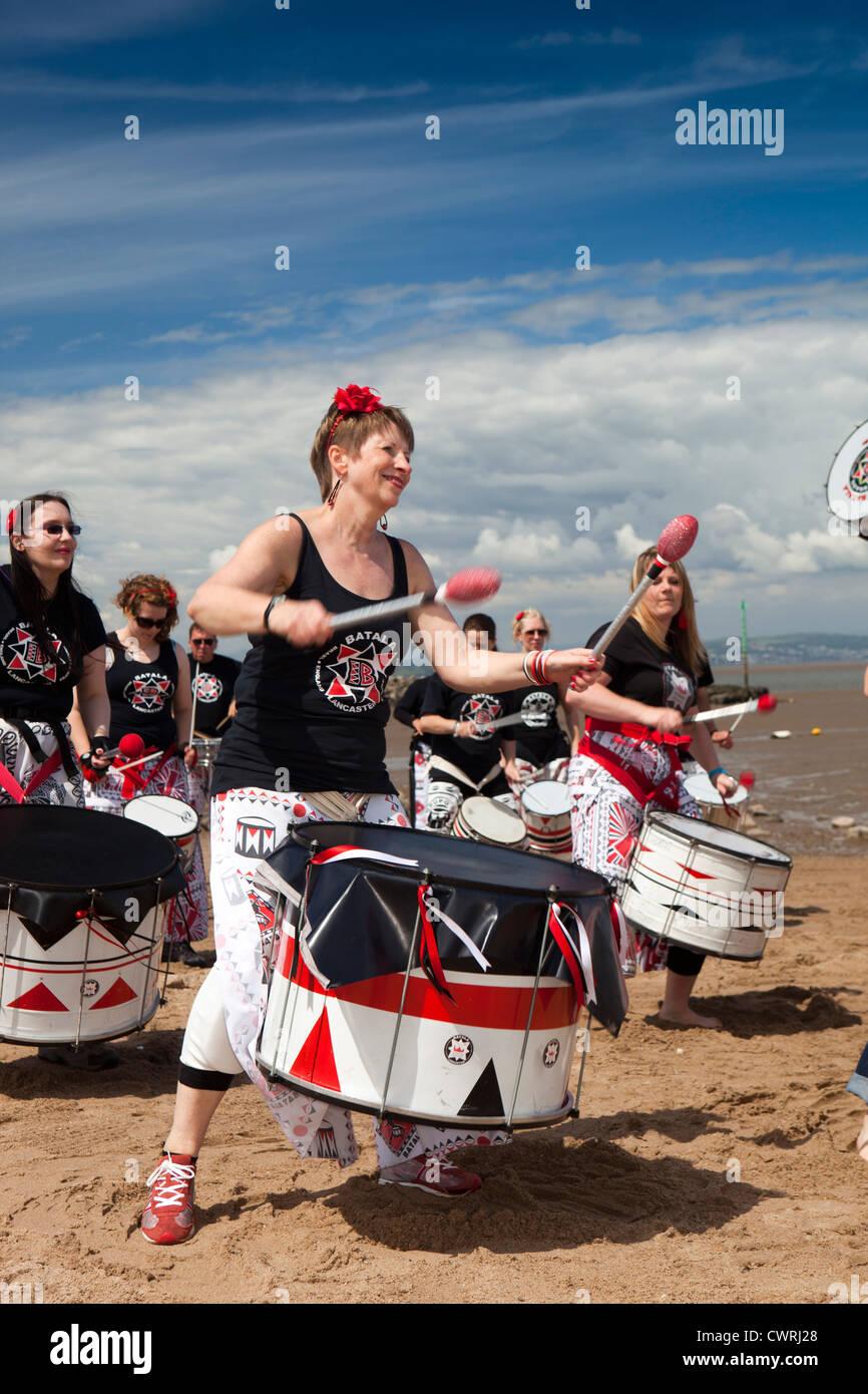 UK, England, Lancashire, Morecambe, Batala Brazilian drumming troupe on beach - Stock Image