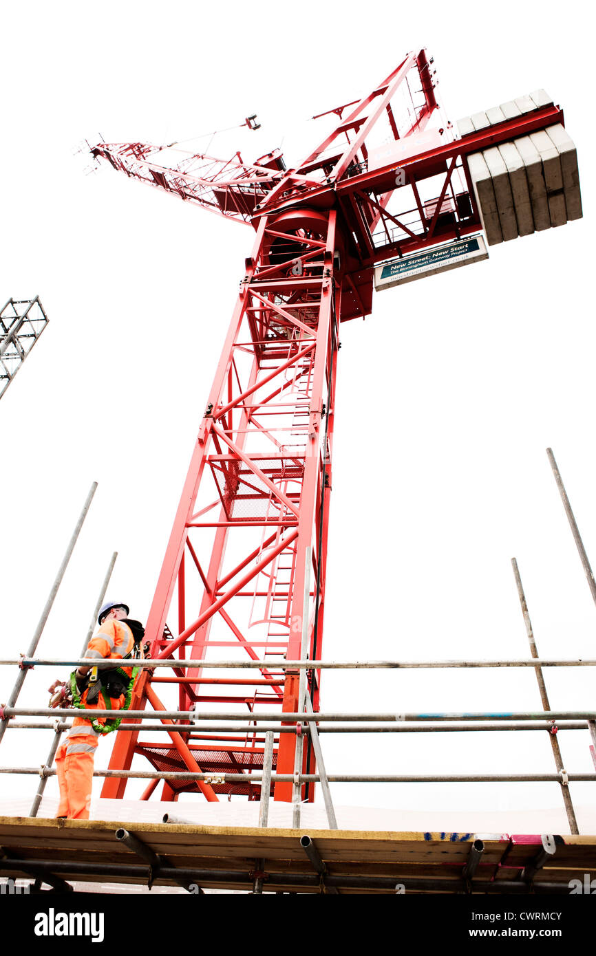 Scaffolding and crane at construction site UK - Stock Image