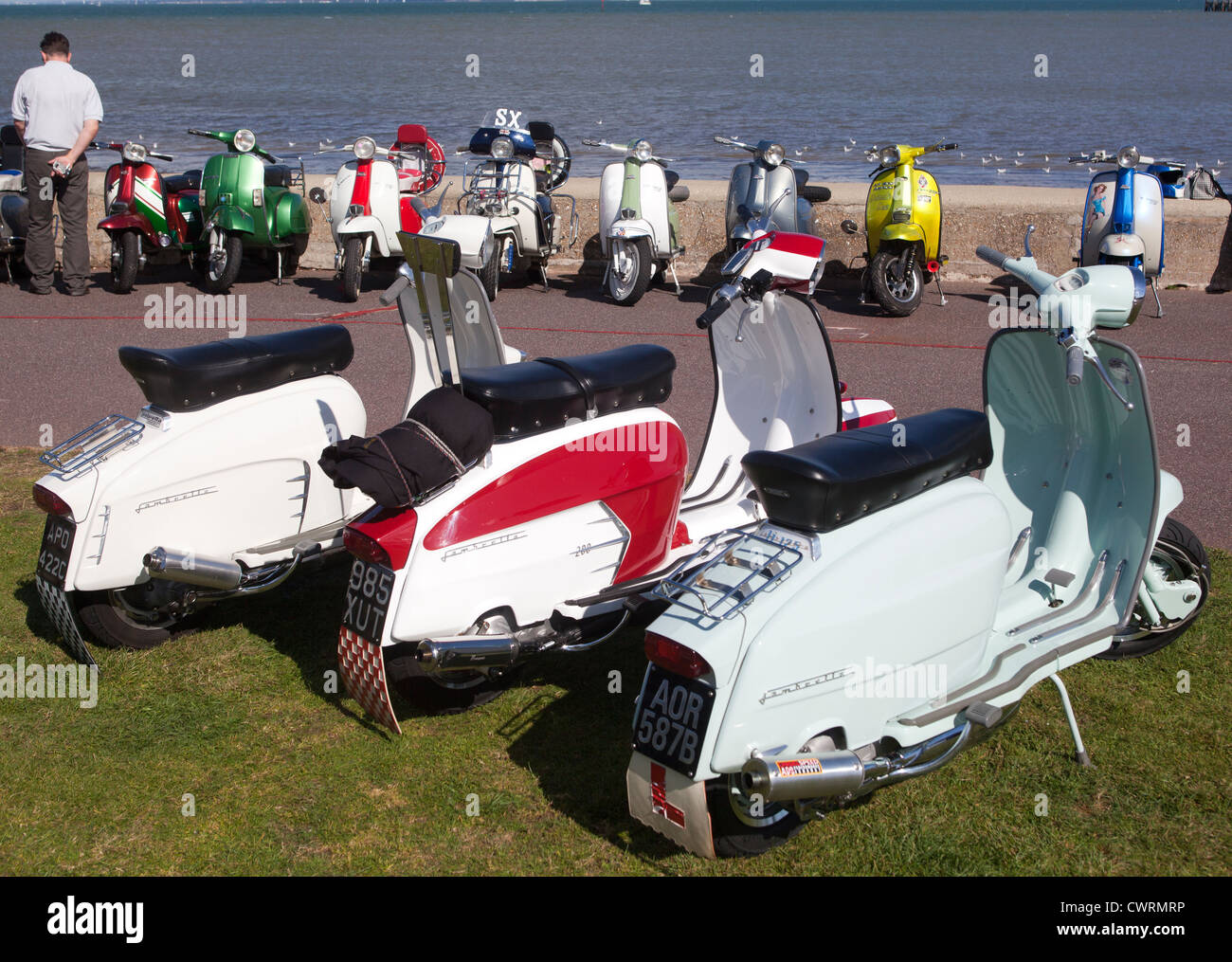 Scooters parked on seafront at Ryde - Stock Image