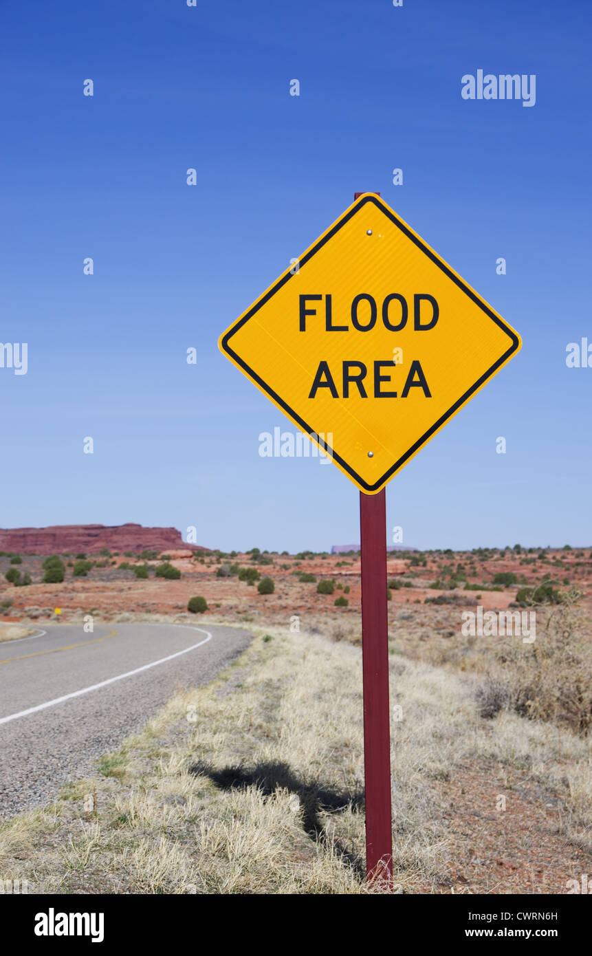 vertical image of flood area sign in the desert - Stock Image