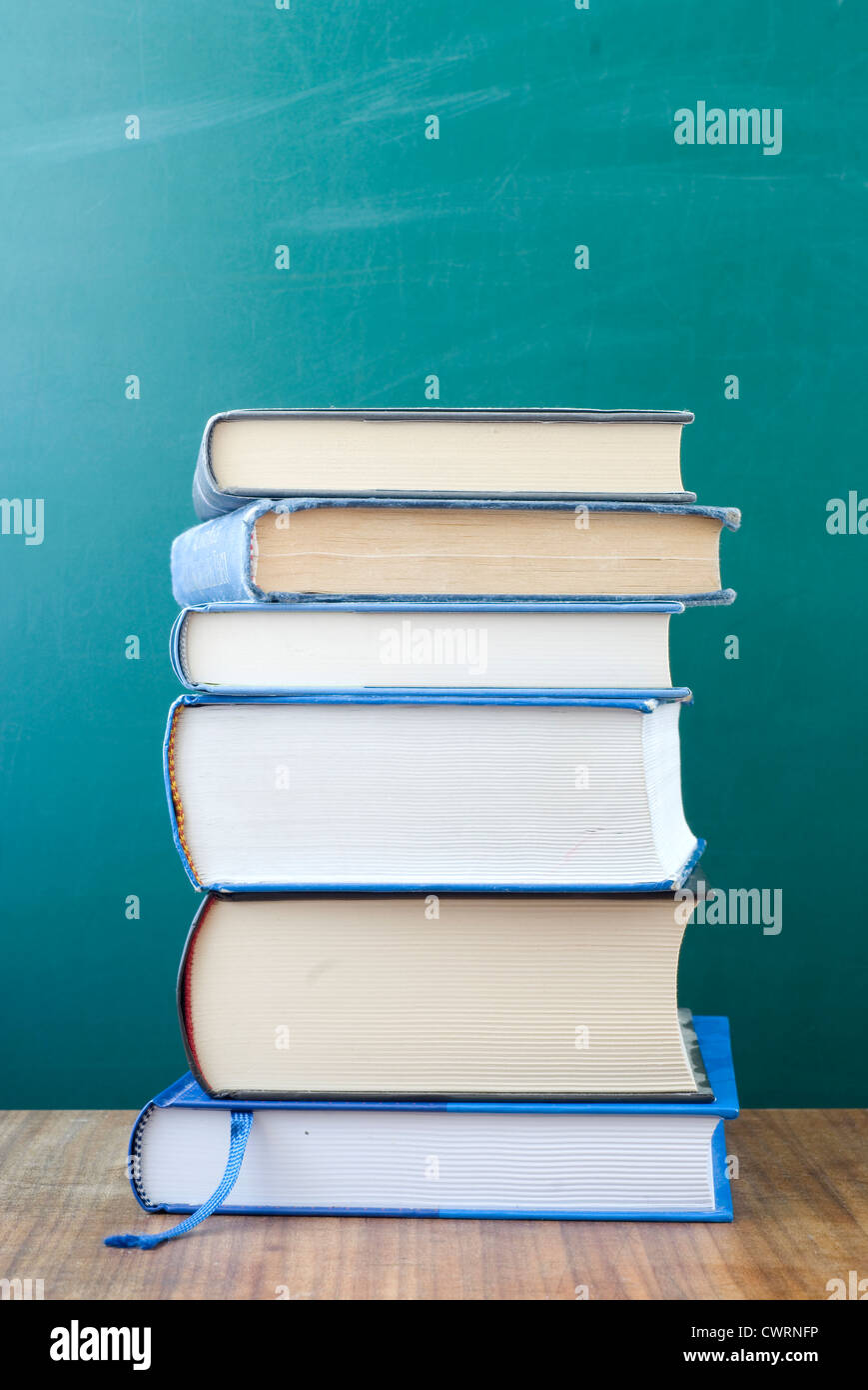 Pile of books on the desk. - Stock Image