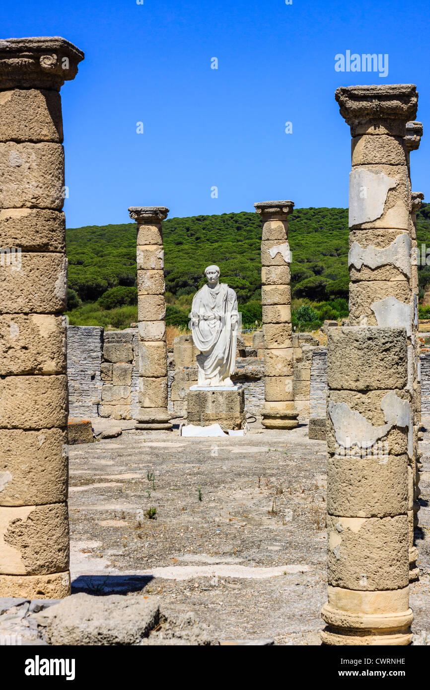 Trajan statue and Basilica at the Roman ruins of Baelo Claudia in Bolonia beach , Tarifa , Cadiz , Andalusia , Spain Stock Photo