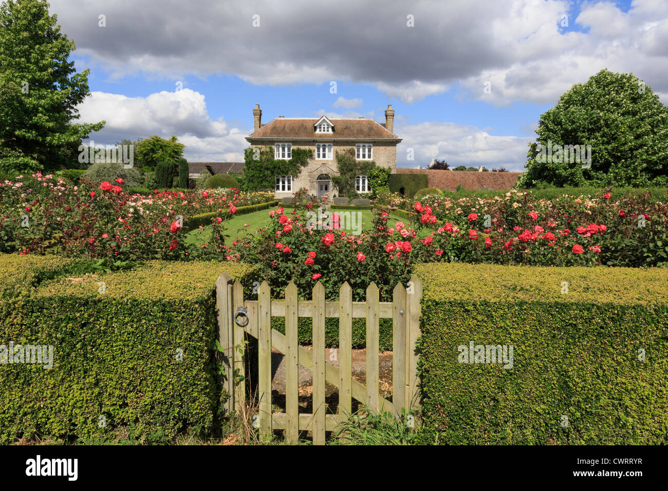 Hedge With Gate To Rose Garden In Front Of A 19C English Country House Summer Pluckley Near Ashford Kent England UK
