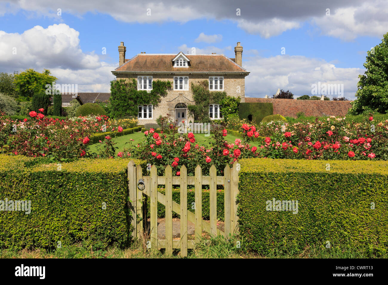 Hedge With Gate To Rose Garden In Front Of A 19th Century English Country House Summer Pluckley Kent England UK Britain