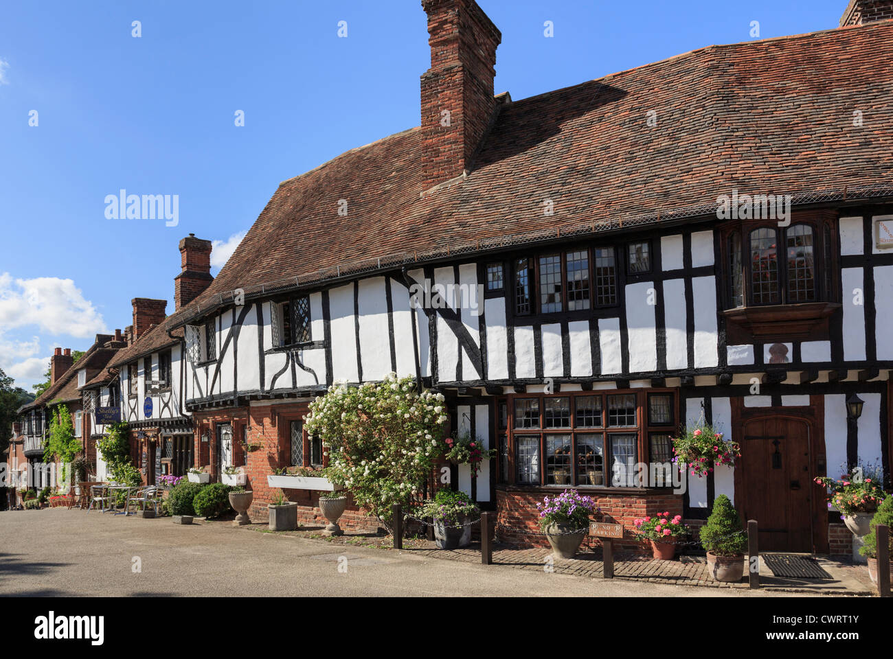 Row of timber-framed Tudor period houses in picturesque medieval Chilham village square, Chilham, Kent, England, - Stock Image