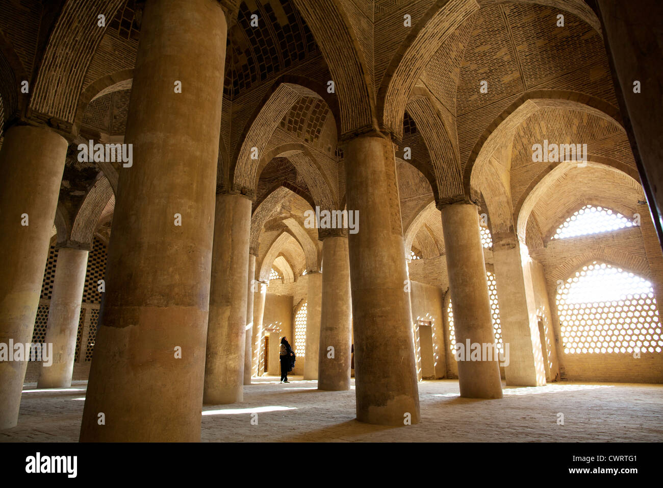 In the great columns room of the Gigantic mosque of Isfahan - Stock Image