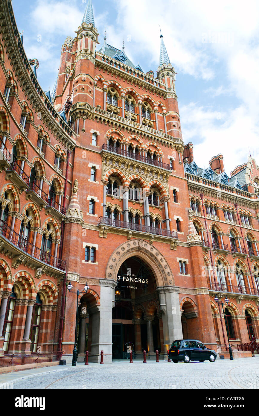 St Pancras Station in London with Black London Taxi - Stock Image