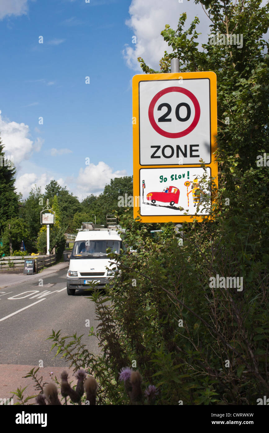 Traffic calming measures in the UK often include the use of children's drawings on speed limit signs in built - Stock Image