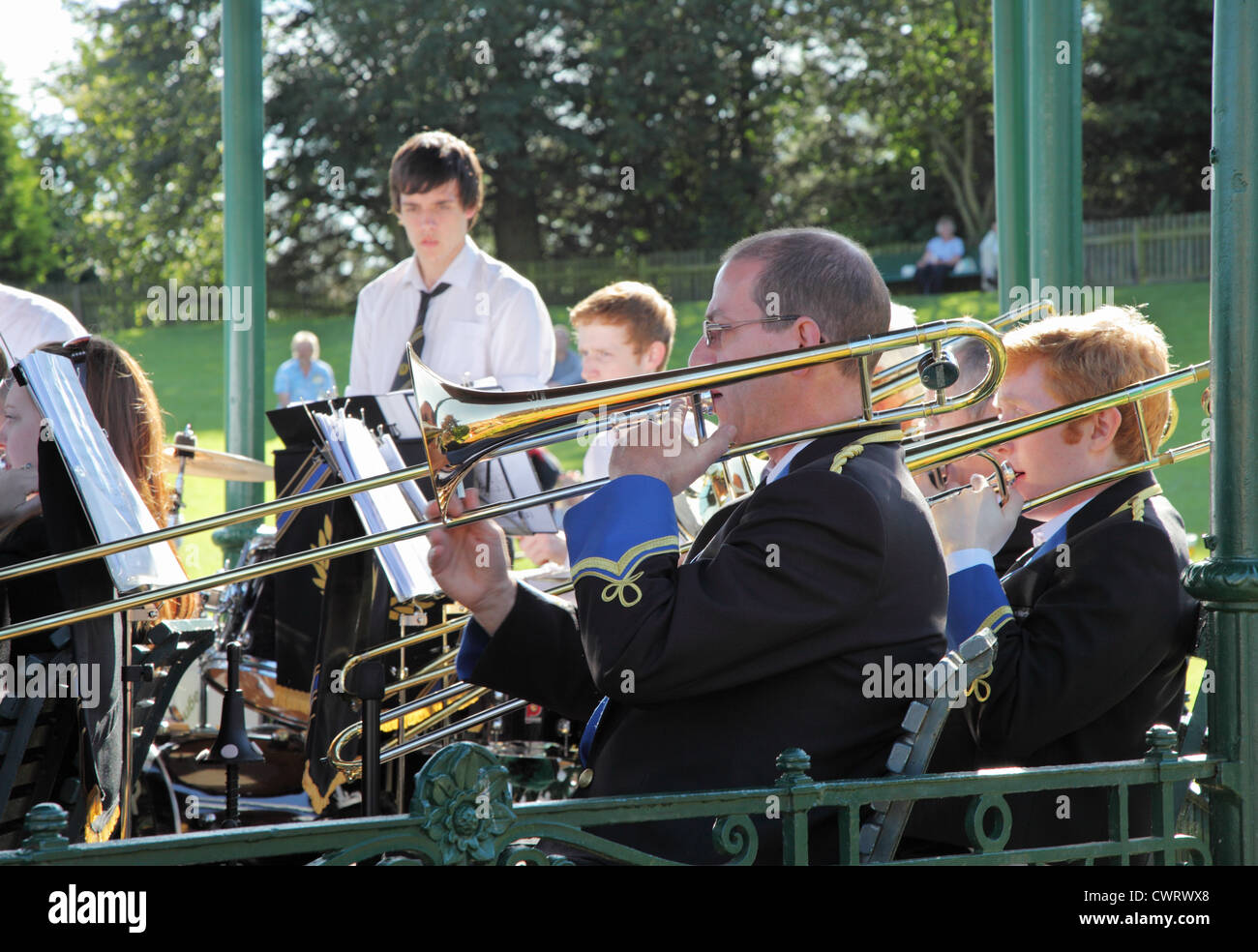 Musicians,from Annan Town Band, playing trombones within the bandstand at Beamish Museum, north east England, UK - Stock Image