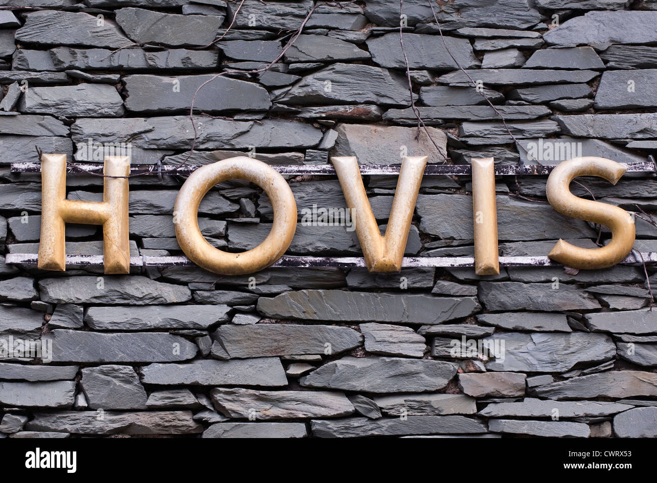 An old Hovis advertising sign on a Cumbrian house wall. - Stock Image