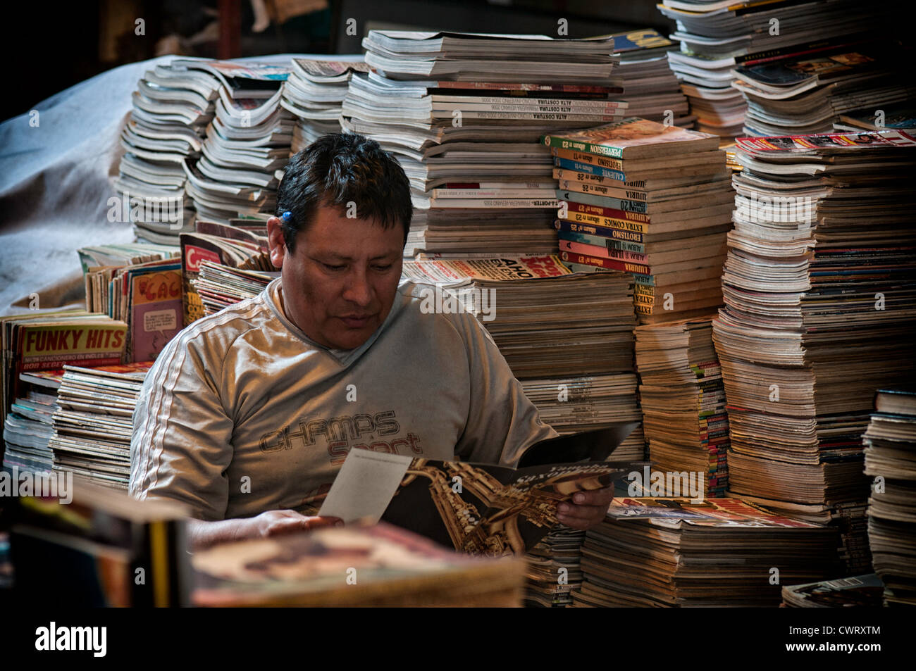An old book and magazines seller in Lima, Peru - Stock Image