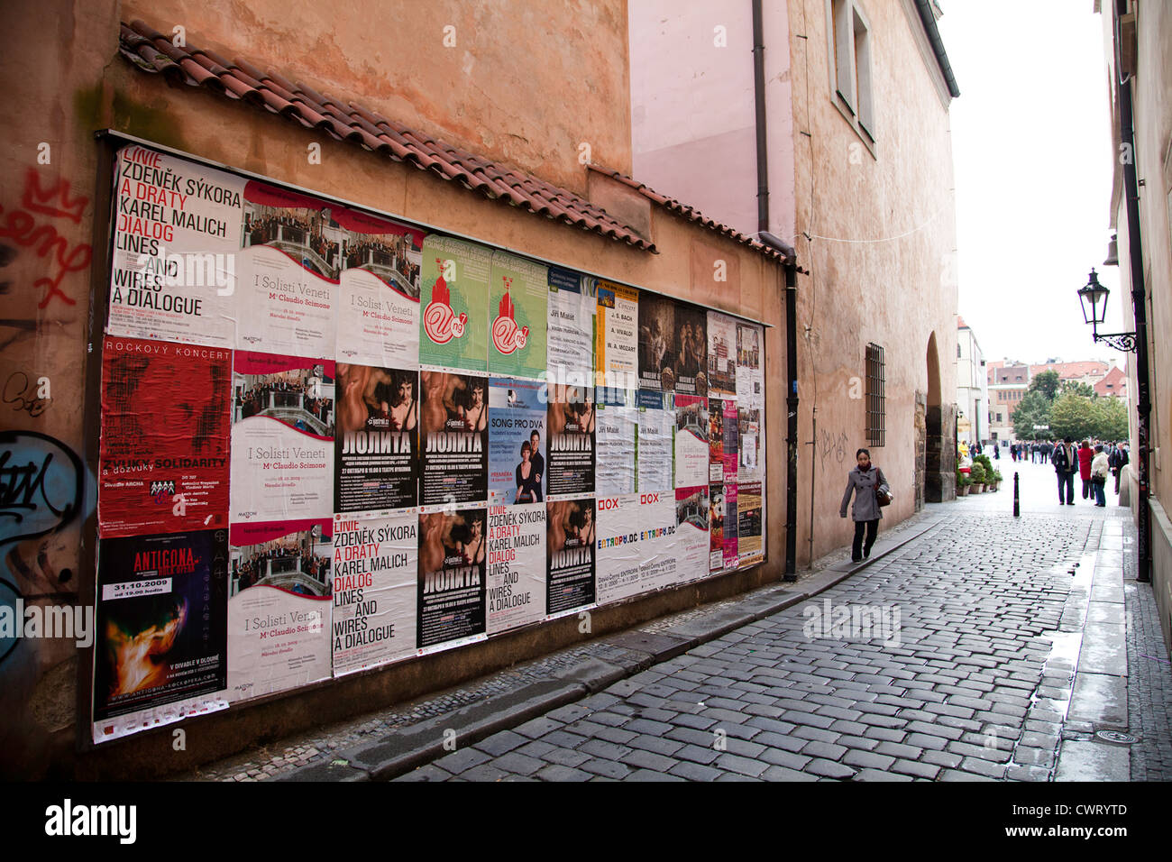 Prague, Czech Republic: Typical street scene, complete with billboard and graffiti, near Old Town Square. - Stock Image