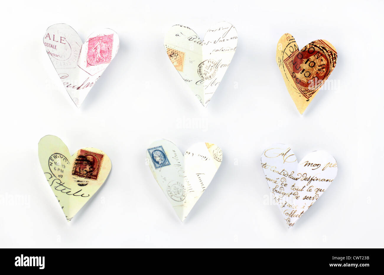 Flying love letters cut out of old letters - Stock Image