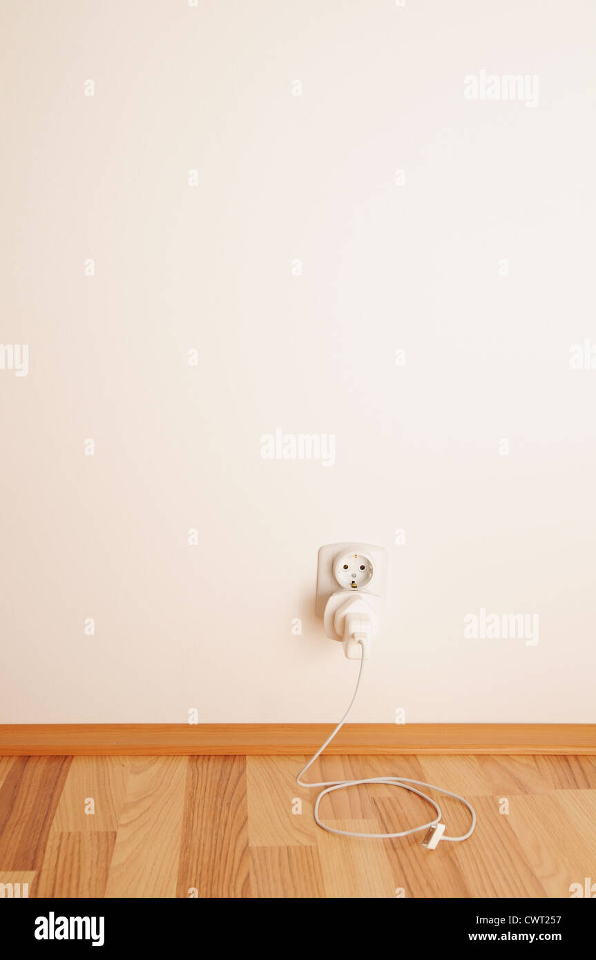 Electric socket with cable, unplugged from the device. - Stock Image