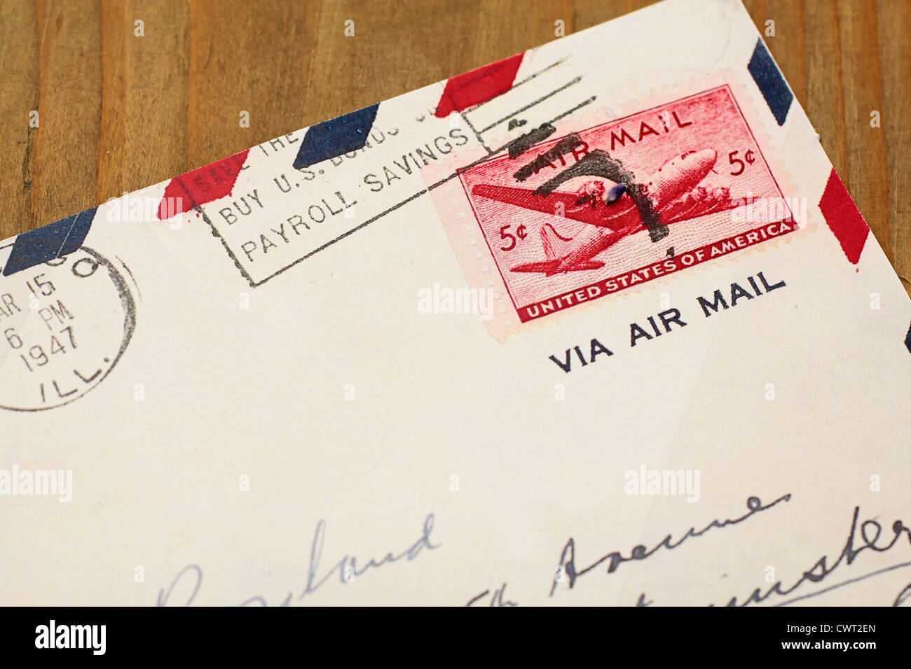 Close up of old airmail letter from the US on wooden desk - Stock Image