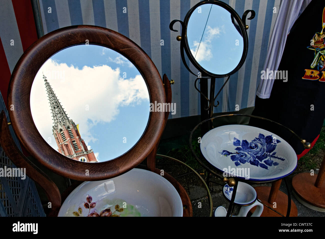 Maria Hilfe Church reflecting in mirror, Auer Dult, Munich Upper Bavaria Germany - Stock Image