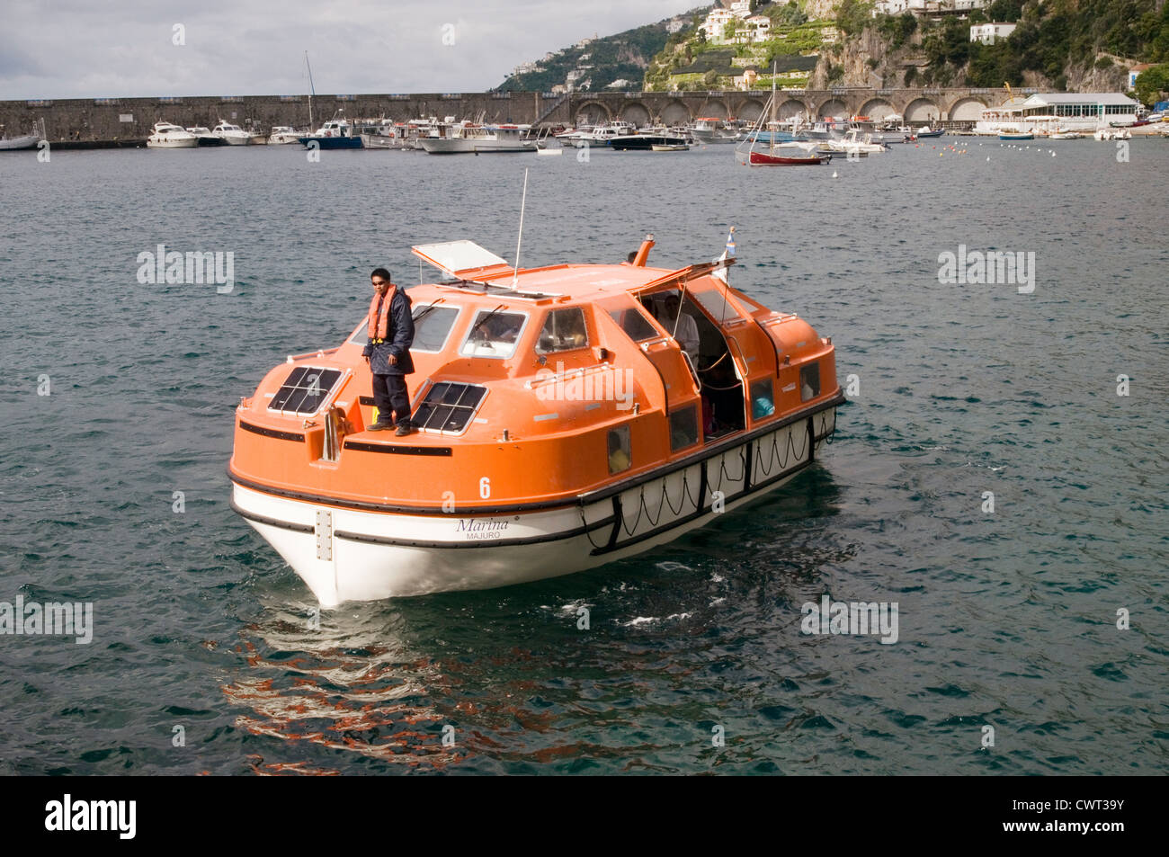 cruiseship cruise ships ship lifeboat lifeboats boats life being launched passengers being evacuated Stock Photo