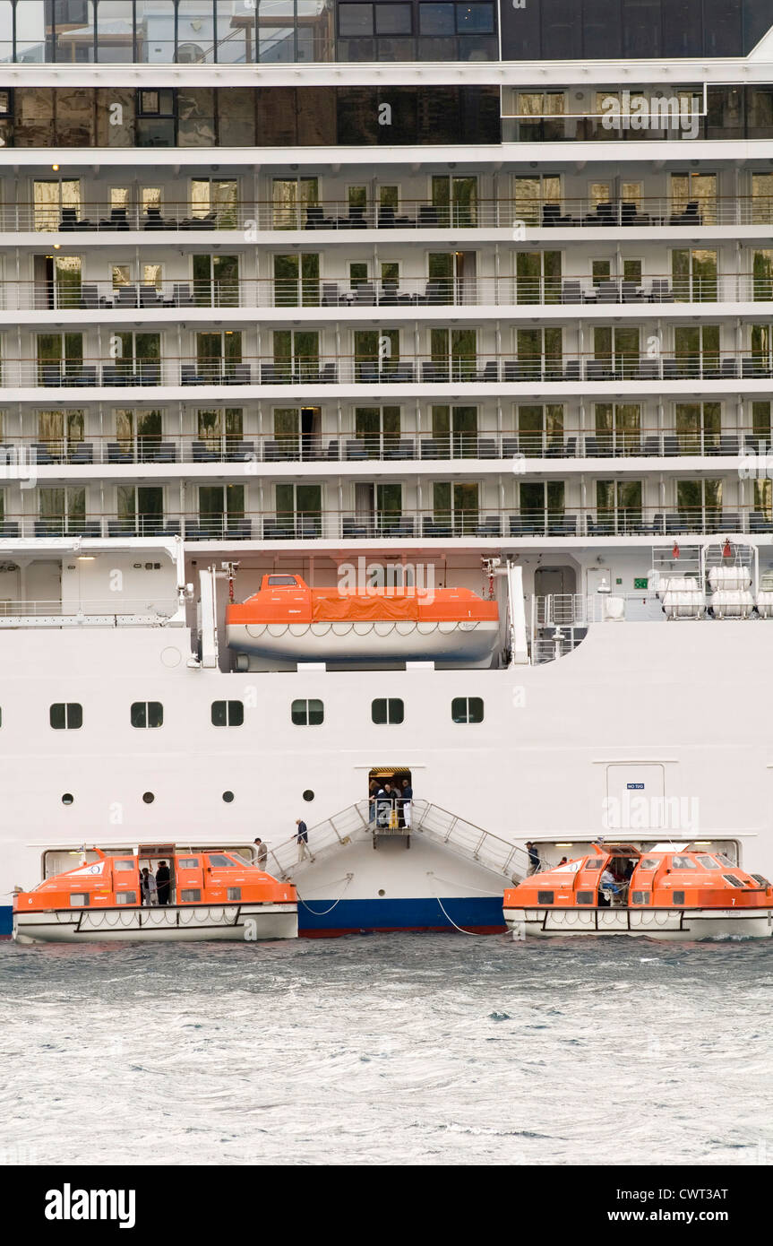 cruiseship cruise ships ship lifeboat lifeboats boats life being launched passengers being evacuated - Stock Image