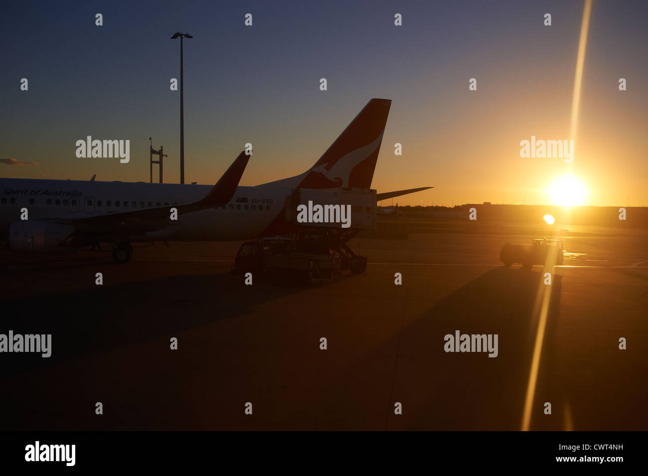 Qantas jets in silhouette on the tarmac at the Brisbane airport terminal Australia Stock Photo