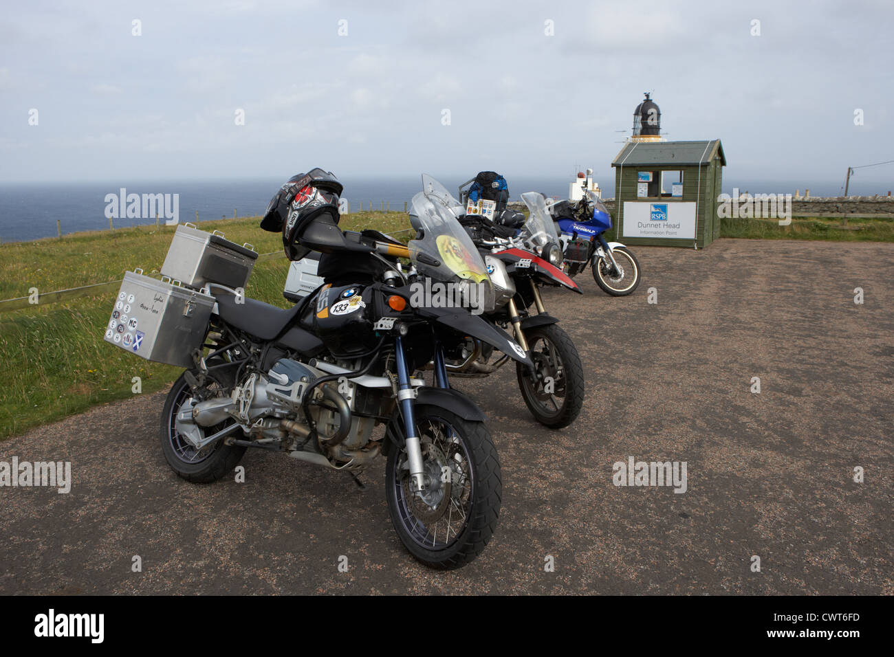 touring european motorcycles at dunnet head scotland uk - Stock Image