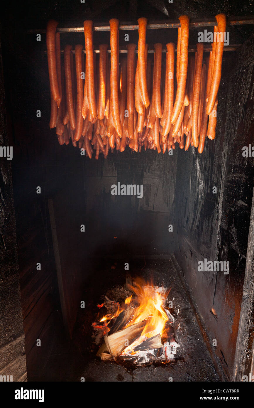 Smoking Sausage Over Wood Fire In Smokehouse In La Place