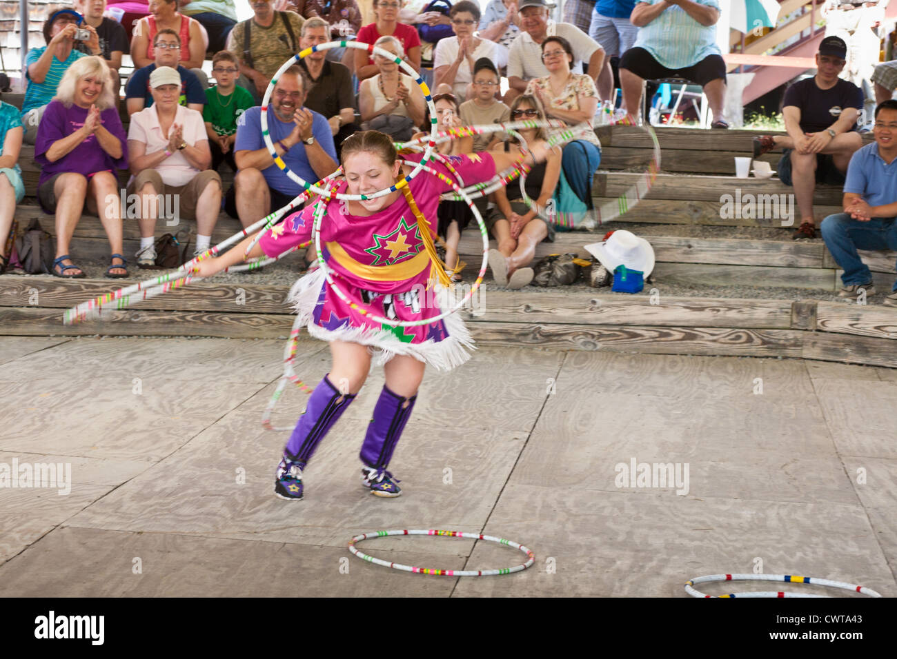 Girl, 15, Ojibwe tribe, hoop dancing at Iroquois Museum Festival, Schoharie County, New York State - Stock Image