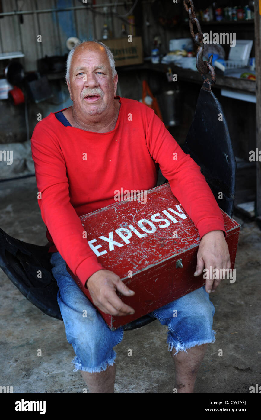 Man holds Explosives box - Stock Image