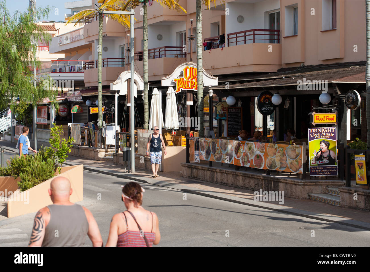 Street in San Antonio, Ibiza, Spain, with holiday apartments, bars and restaurants, catering for mainly British - Stock Image