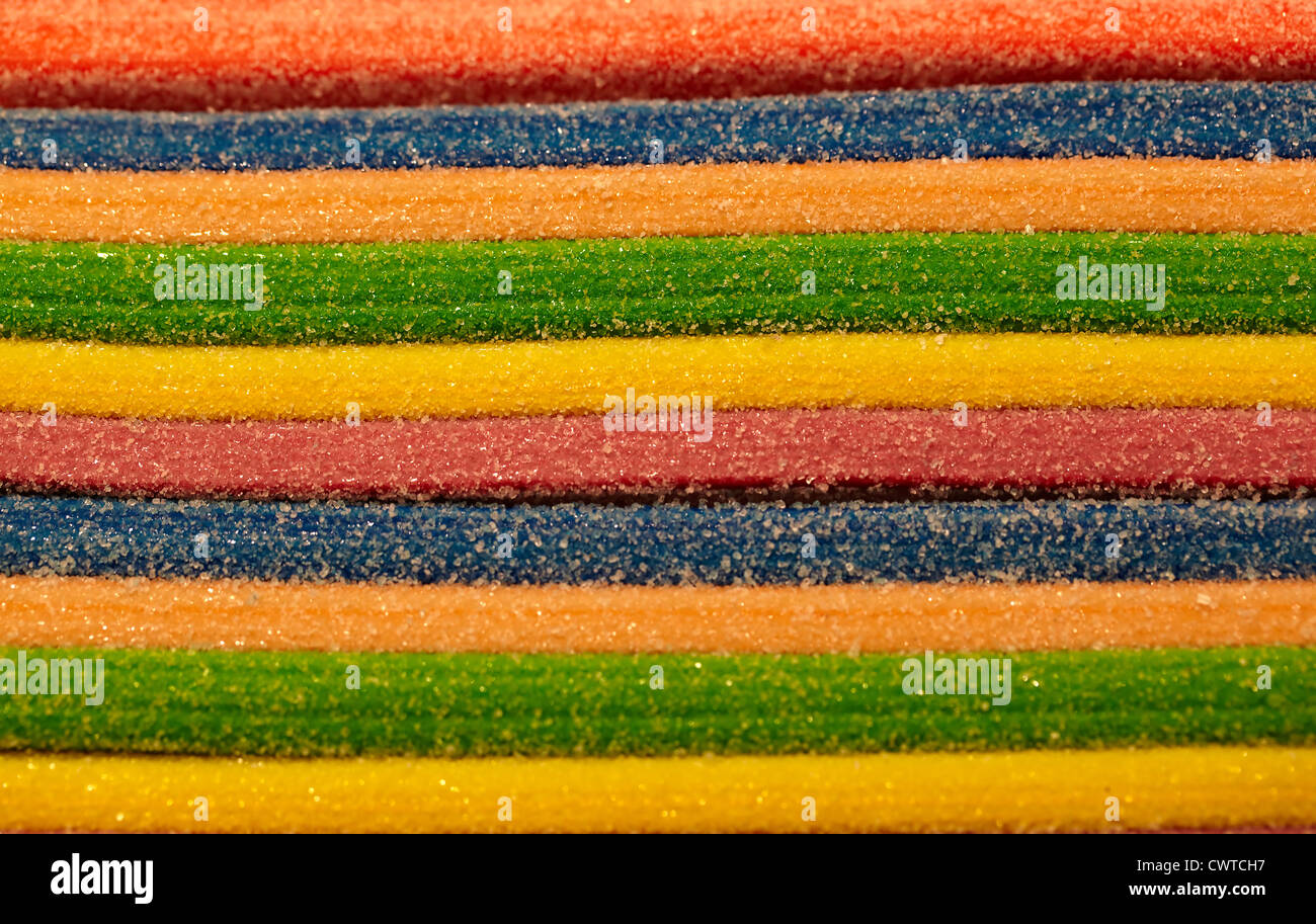 Many-color layer sweetness sprinkled with sugar. Abstract background. - Stock Image