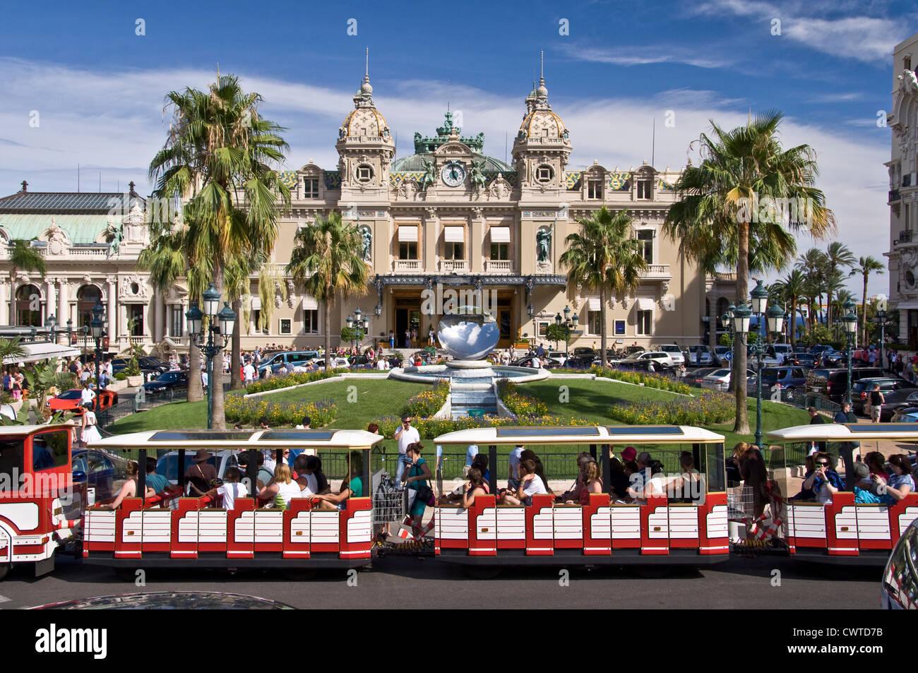 Touristic small train in front of the casino of Monte-Carlo - Monaco - Stock Image